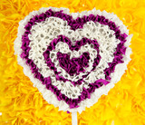 Decorative heart from paper on yellow background