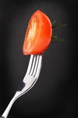 cut tomatoe on a fork
