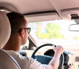 Man driving a car. Inside shoot
