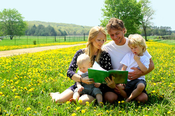 Family Reading in a Field of Dandelions