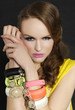 glamour girl with bright make-up-and color bracelet