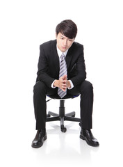 Frustrated and thinking business man sitting