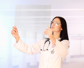 Woman doctor holding x-ray , standing on hospital