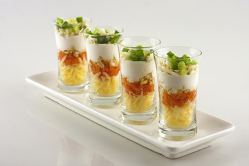 verrine of cheese on a white plate