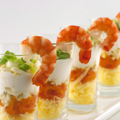 verrine salad with  cheese  served in glass with a shrimp on top