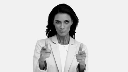 Businesswoman snapping her fingers and pointing