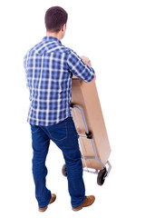 Young casual man moving a boxe with dolly, isolated on white bac