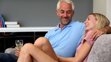 Mature couple talking each other on a sofa
