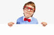 School boy in red glasses holding white square