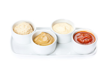 several types of sauce on a white background