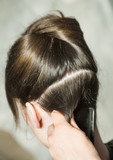 Closeup of combing back side hair part