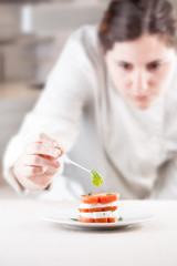 Cook serving tomato and mozzarella slices