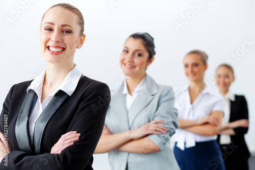 Four businesswomen standing in row