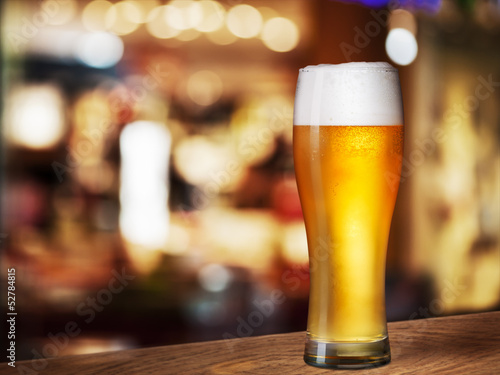 cold beer glass on bar or pub desk