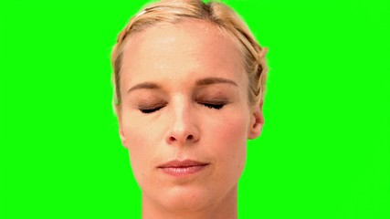 Woman showing her anger on green screen