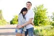 Boy and girl embracing