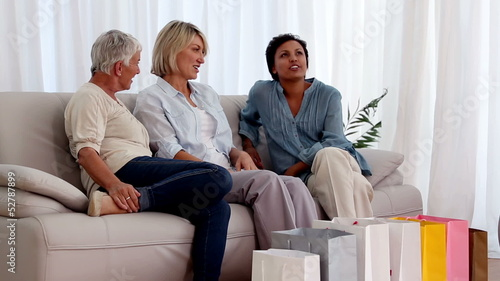 Mature friends chatting on the couch