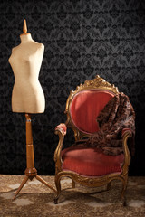 old styled tailor mannequin and armchair