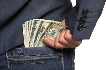 Male hand draws out a money from the pocket of jeans, close-up