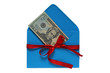 dollars in blue envelope tied with red ribbon. money gift