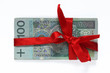 hundred polish money tied with red ribbon isolated on white