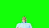 Man catching an orange segment with mouth on green screen