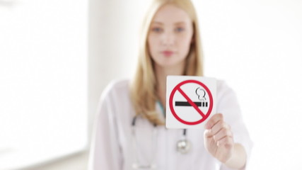doctor showing no smoking sign