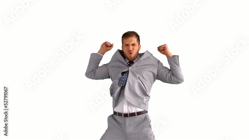 Excited businessman jumping on white background