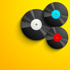 Musical concept with vinyl disc on yellow background..