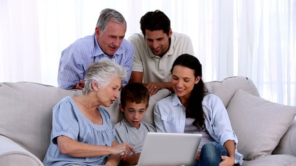 Extended family using laptop together