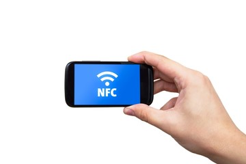 Hand holding smartphone with NFC technology - near field communi