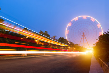 Night, a rotating Ferris wheel.
