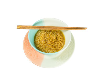 Instant noodle and chopsticks isolated on white background