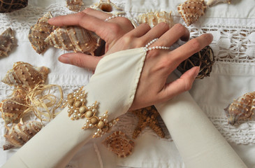 Shells and bride's hands
