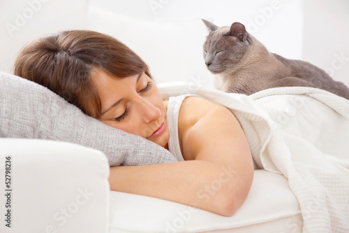 Portrait of a young woman sleeping on the bed