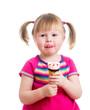 little girl eating ice cream in studio isolated