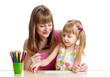mother and her kid girl draw together