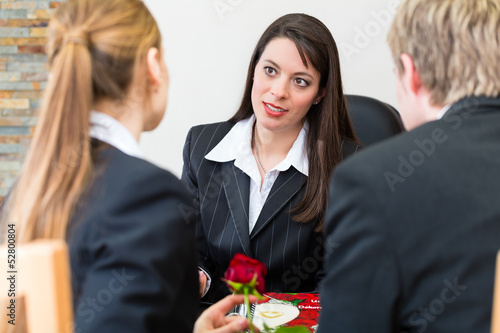 mortician with client comforting and advising - 52800804