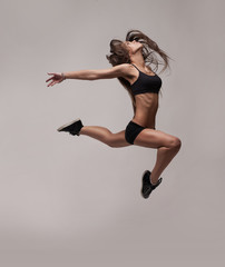 caucasian fitness woman jumping