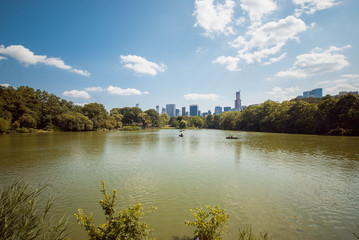 NYC Central Park lake skyline reflection down