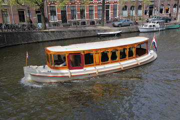 City of Amsterdam with boat on canal in Holland