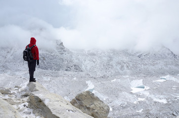 Mountaineer standing near Khumbu Icefall - one of the most dange