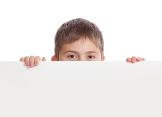 Boy emerge from behind poster