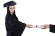 Attractive graduate given certificate - isolated