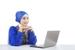 Beautiful muslim looking at laptop - isolated