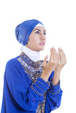 Beautiful girl in blue muslim dress on white