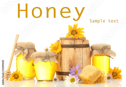 Honey in banks and barrel isolated on white