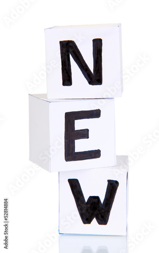 "White paper cubes labeled ""News"" isolated on white"
