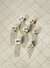 Polyhedral dice on blank square grid game map used in game