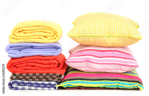Bright pillows and plaids, isolated on white